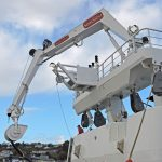 The SeaQuest crane mounted atop the trawl gantry is fitted with a powerblock featuring hydraulic tilt and continual rotation.