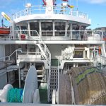 Life and mid-line winches are positioned at boat deck level, above the split trawl winches and net drums.
