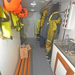 Heated protective clothing room, starboard side aft.