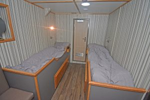 Two-berth skipper's en suite cabin at boat deck level, port side forward.