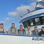 A happy Audacious crew after a successful first trip. Left to right: Ian 'Chocky' Anderson, Matthew Pirie, Gavin Wiseman, James Napier, Barry Reid, Harry Smith, Bryan Sangster and David Gatt.