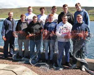 Tutor Mark Fullerton with the boys who participated in the first of two Seafish Introduction to Commercial Fishing courses held at NAFC this year, due to increased demand for places. Magnus Polson (second left, back row) subsequently joined the crew of the new Whalsay seine-net boat Tranquility, featured in Fishing News, 26 July. (Left)