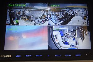 The split-screen CCTV display in the overhead console includes imagery from the underwater camera monitoring the propeller and rudder.