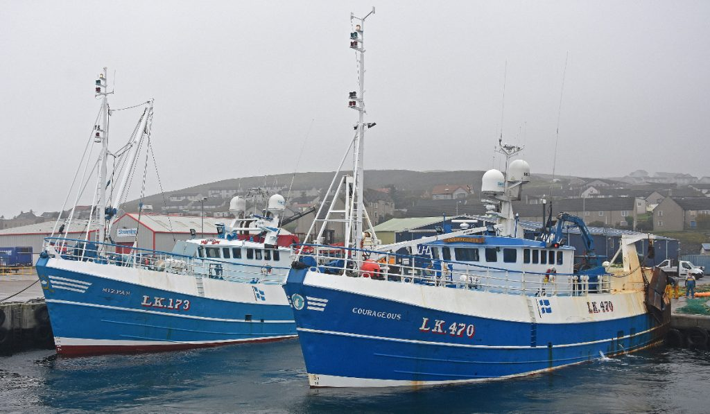 The Campbeltown 87 whitefish trawlers Mizpah and Courageous stern-on to Mair's Quay, as the crews look over the gear.