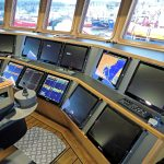 The main forward console in the well-finished wheelhouse…