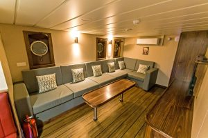The day lounge is arranged in the forward starboard corner of the full-width deck house on the main deck…