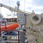 A Palfinger davit-arm crane mounted forward serves the rescue boat.