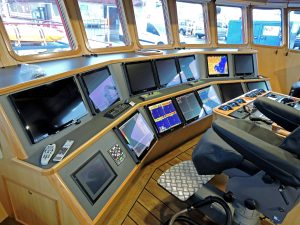 Flush-mounted screens in the main wheelhouse console display information from units supplied by Tom Hand and Barry Electronics.
