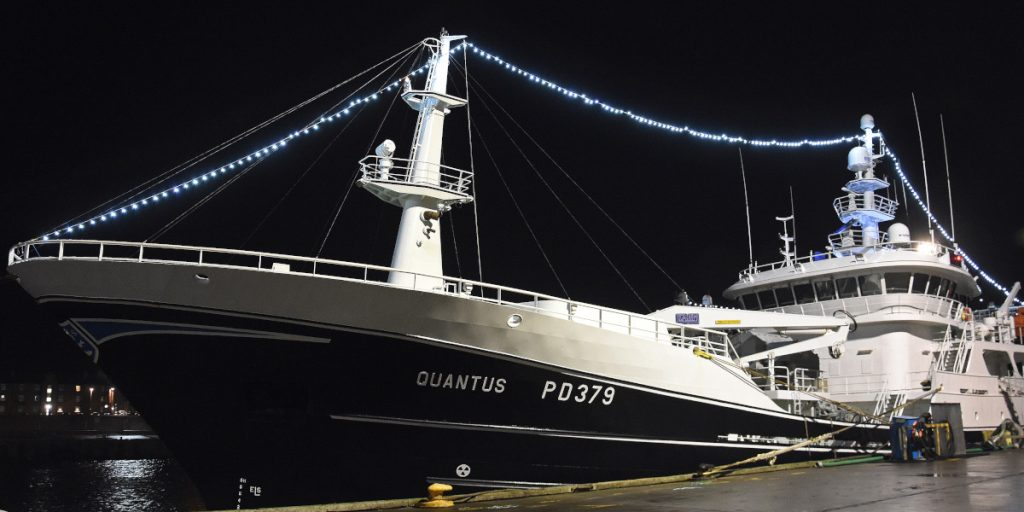 The 65.5m midwater trawler Quantus dressed overall with high-intensity LED lights on the Albert Quay.