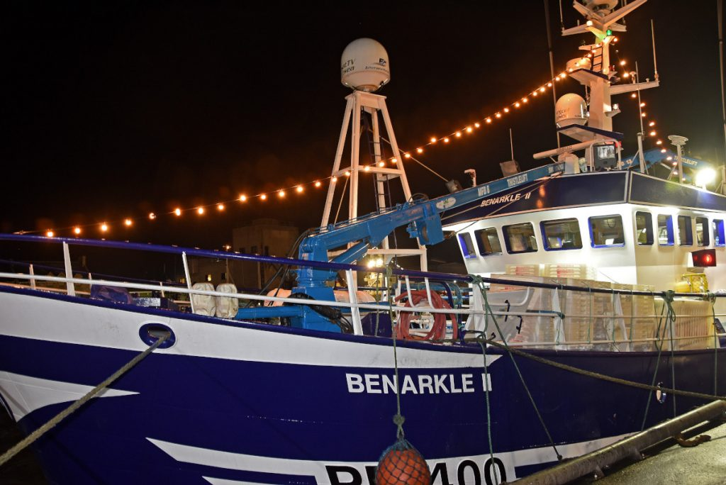 Benarkle II, brightly illuminated alongside the road in the south harbour.