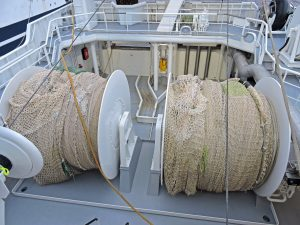 Two net drums are aligned with hydraulically operated shooting gates and rollers across the stern of Girl Stephanie...
