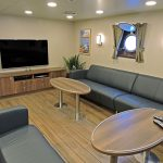 The day lounge is situated in the forward port corner of the accommodation casing...