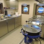 The stainless steel galley…