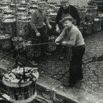 A drifter crew landing herring in traditional wicker baskets at Buckie.