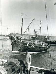 ‡ Integrity precedes another two local trawlers in to land at Buckie.