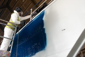 A vessel being repainted in Killybegs' ship hall by GCM Painting.