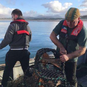 Irish inshore fishermen wearing Mullion PFDs to enhance their fishing safety.