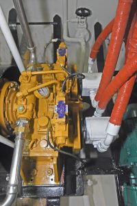 A gear retrieve system is run off the fore end of the main engine by a Dong-I power take-off and standby hydraulic pumps.