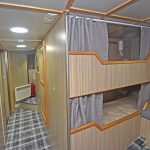 Two of the five beds arranged to port in the full-width accommodation cabin.