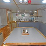 The messdeck and galley run the full length of the deckhouse on the port side.