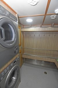 Laundry facilities are built into the heated deck clothing room…