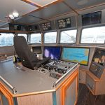 A skipper's seat is built into a central island unit aft of the main forward console.