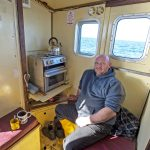 Daz puts the kettle on for teas and coffees in the wheelhouse.