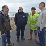 Communication is what Nick O'Neill's role is all about – Nick (second left) talking with Selsey fishermen Chris Harvey, Jeremy Lawrence and Mike Harvey. (Photos Geoff Lee)