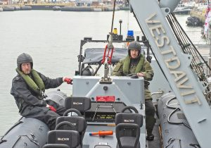 LS (AWT) Matthew Hutchins (coxswain) and AB Stephen Hart Bowman (RN reserves) prepare to be lowered to the water in one of Forth's two Pacific 24 RIBs.