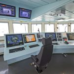 HMS Forth's main controls and operating screens on the bridge.
