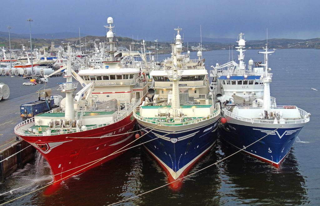 The Fraserburgh midwater trawler Christina S discharging blue whiting on the new pier at Killybegs, berthed on the inside of the Norwegian vessels Gunnar Langva and Vea, before Storm Gareth hit the west coast of Ireland. (Photos: Ryan Cordiner)