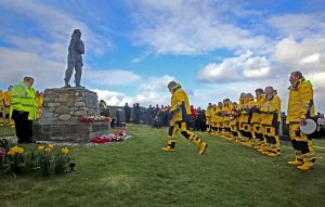 Longhope coxswain Kevin Kirkpatrick laying a wreath during the ceremony at Kirk Hope.