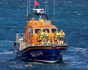 The Longhope lifeboat crew, onboard the relief 16m Tamar Edward and Barbara Prigmore, lay a wreath in memory of the eight lifeboat men lost 50 years earlier.