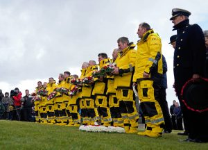 Longhope, Stromness, Thurso and Wick lifeboat crews form a guard of honour at the Kirk Hope ceremony.