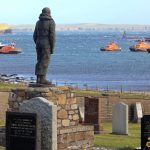 Lifeboat crews pay their respects at the lifeboat memorial at Kirk Hope.