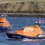 Longhope relief lifeboat Edward and Barbara Prigmore passing Thurso's 17m Severn lifeboat The Taylors at Aith Hope, opposite the old lifeboat house.