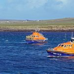 Longhope, Thurso and Wick lifeboats form up in line as they pass the old lifeboat house.