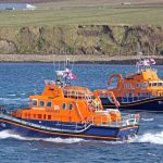 Stromness and Thurso lifeboats paying their respects to the Longhope lifeboat crew at Aith Hope.