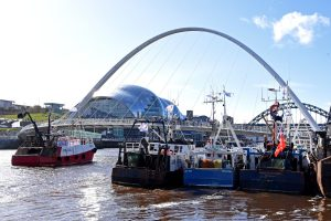 Trawlers berthed on Newcastle quayside, downstream of the iconic Millennium and Tyne bridges.