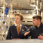 The Princess Royal listens intently as factory manager Graham Barney explains some of the highly automated equipment on the processing deck.