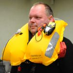 Clive Palfrey with the latest Mullion lifejacket designed for fishermen.