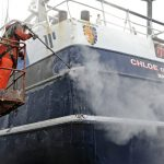 The beam trawler Chloe of Ladram is being stripped of all paint from the rail to the keel in preparation for a full repaint by Steven Green and his staff at Toms Boatyard.