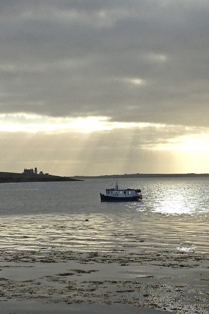 The Orkney creel boat Mary Jean off Helliar Holm in early morning light. (Helen Jones)