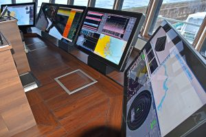 The Furuno big bridge system is driven by an advanced video wall controller integrated into touch-screen command units.
