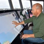 Bruce Hardy of Furuno UK demonstrates how to programme course plotting on the MaxSea TimeZeros, while sitting on the lower-level seat.
