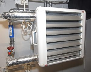 … that distribute recycled hot water to fan units installed in every compartment on Taits.