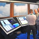 Punching weather – Woodsons promoted a wide range of electronic equipment on an eye-catching stand set against a backdrop of a trawler steaming into fresh weather.