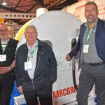 MacGregor electric – Whalsay skipper Davie Hutchinson, with Julian Ramsey and Morten Stenkjær from MacGregor, and the electric fish pump that will be used on the new midwater trawler Charisma, currently being built by Karstensens shipyard.