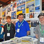 Youthful tradition – friends and future fishermen Hayden Mottram, Campbell McDermott, Matthew West and Josh Buchan, photographed for the fifth year in succession at Aberdeen on the Fishing News stand – appropriately under a photo of Shaulora LLP's recent acquisition Jolanna M BF 29, which is partly named after Josh and Matthew.