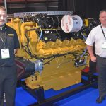 New power – Andrew Clink and Gordon Dalrymple on the Finning UK stand, with a Caterpillar C32 main engine scheduled for installation in the next twin-rig trawler to be built by Macduff Shipyards Ltd.